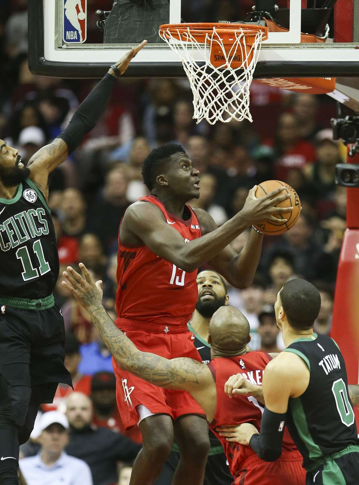 Houston Rockets center Clint Capela (15) goes up for a reverse layup against Boston Celtics guard Kyrie Irving (11) in the first half of NBA game action at the Toyota Center on Thursday, Dec. 27, 2018 in Houston. Capela had 38 points in the Rockets' 127-113 win.