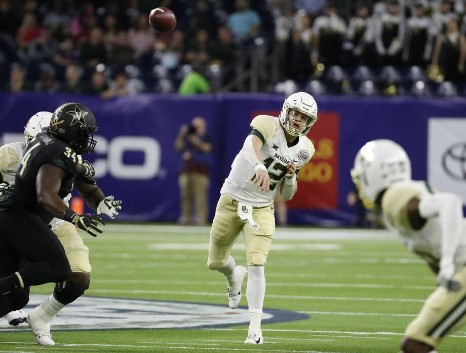 Baylor quarterback Charlie Brewer (12) throws a pass against Vanderbilt during the first quarter of the Academy Sports & Outdoors Texas Bowl at NRG Stadium on Thursday, Dec. 27, 2018, in Houston. Photo: Brett Coomer/Staff Photographer