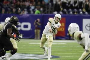 Baylor quarterback Charlie Brewer (12) throws a pass against Vanderbilt during the first quarter of the Academy Sports & Outdoors Texas Bowl at NRG Stadium on Thursday, Dec. 27, 2018, in Houston.