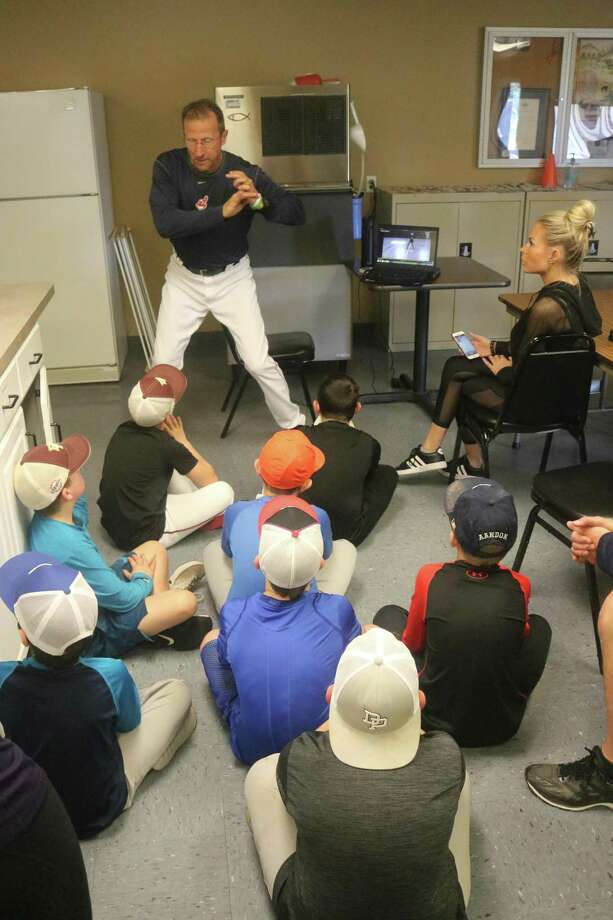 Cleveland Indians scout and former Blinn Junior College head coach Kyle Van Hook addresses a flaw in a kid's stance he saw on one of the videos taken at Thursday's Holiday Baseball Camp. Photo: Robert Avery