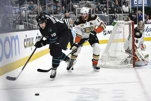 SAN JOSE, CA - DECEMBER 27: Joe Thornton #19 of the San Jose Sharks fights for the puck against Ryan Kesler #25 of the Anaheim Ducks the Anaheim Ducks at SAP Center on December 27 2018 in San Jose, California (Photo by Brandon Magnus/NHLI via Getty Images)