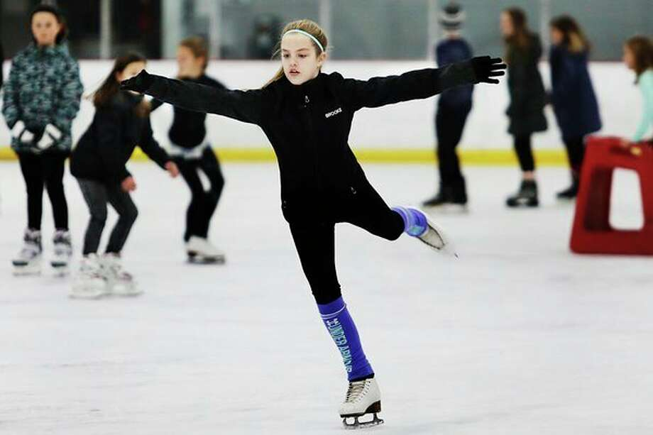 Brooke Dufresne, 10, practices figure skating maneuvers on Thursday at Midland Civic Arena. Dufresne is one of seven skaters from the Midland Figure Skating Club who will take part in the closing celebration of the U.S. Figure Skating National Championships at Little Caesars Arena in Detroit in late January. For the story and more photos, turn to today's Sports section. (Katy Kildee/kkildee@mdn.net)