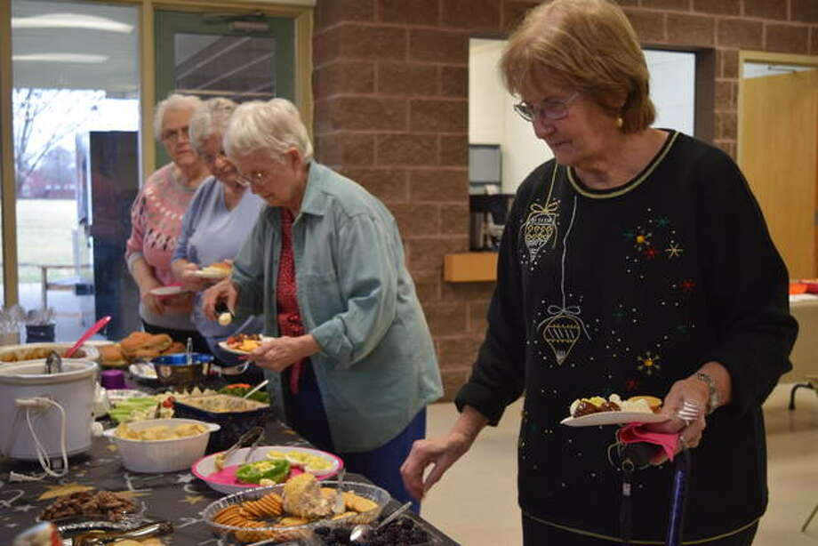 Jacksonville Area Senior Center members enjoy some appetizers Thursday during the center's New Year's Bash. Photo: Nick Draper | Journal-Courier