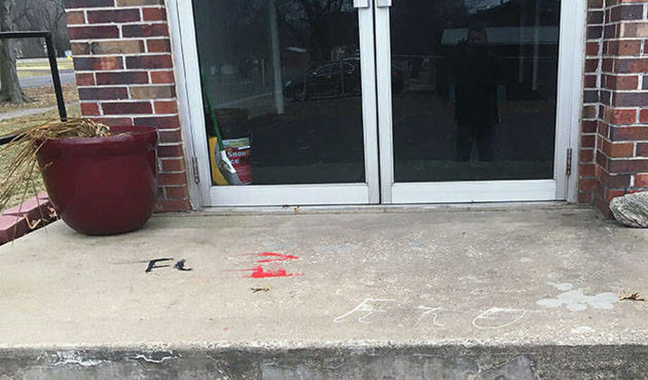 Photo courtesy Morgan-Scott Crime Stoppers Some profanity has been digitally removed from these photos of vandalism at Faith Tabernacle Church in Jacksonville.