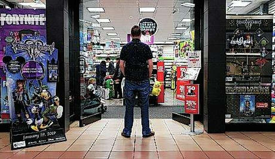 A 27-year-old self-described tech addict stands in front of a video game store. He asked to remain anonymous because he works in the tech industry and fears that speaking out about the negatives of excessive tech use could hurt his career. Photo: Martha Irvine   AP