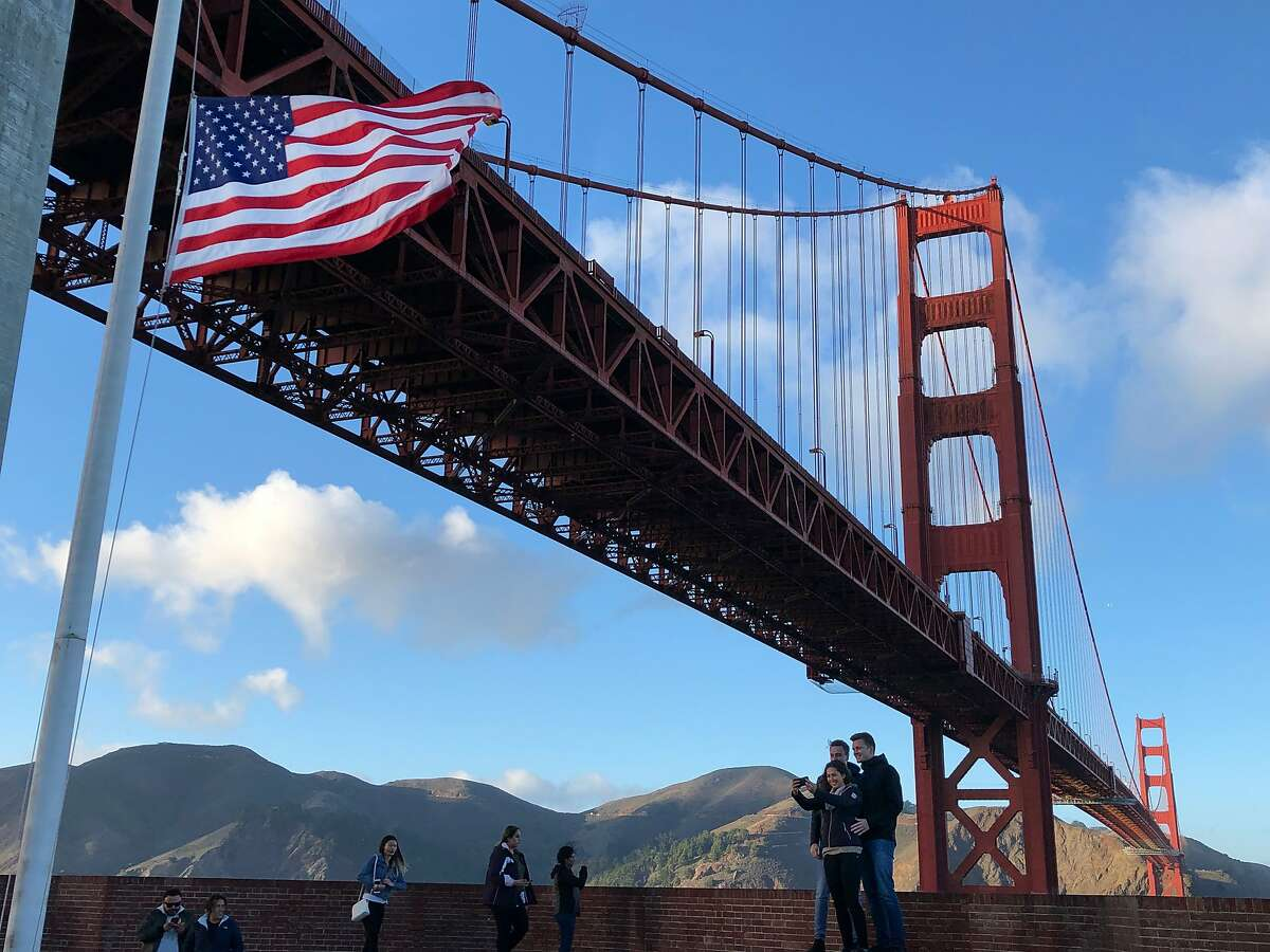 Visitors take photos on the roof of Fort Point on Saturday, Dec. 1, 2018, in San Francisco, CA. The Golden Gate Bridge towers above Fort Point.