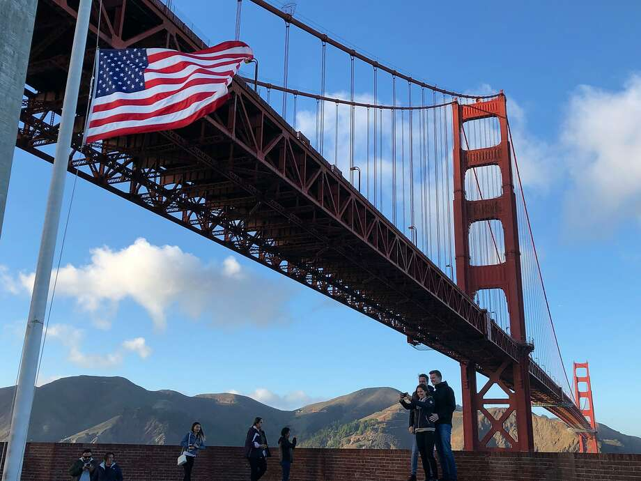 Clear skies and light winds should bring colder temperatures at night to the Bay Area over the New Year's Eve weekend. Visitors take photos on the roof of Fort Point on Saturday, Dec. 1, 2018, in San Francisco, CA. The Golden Gate Bridge towers above Fort Point. Photo: Paul Kuroda / Special To The Chronicle