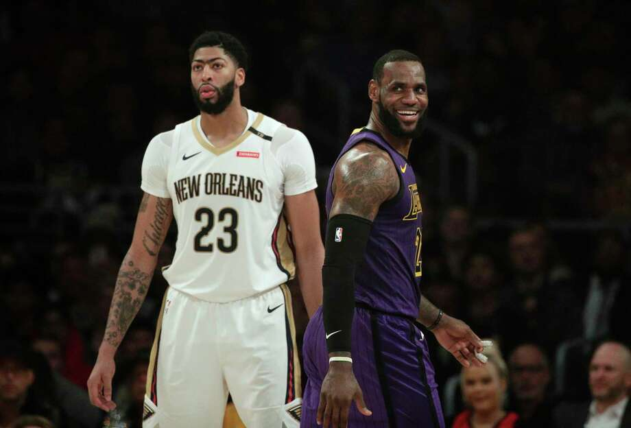 Los Angeles Lakers' LeBron James, right, smiles as he walks past New Orleans Pelicans' Anthony Davis during the first half of an NBA basketball game Friday, Dec. 21, 2018, in Los Angeles. (AP Photo/Jae C. Hong) Photo: Jae C. Hong, Associated Press / Copyright 2018 The Associated Press. All rights reserved.