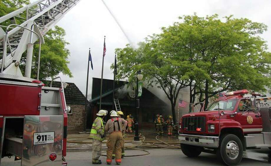 Numerous fire departments were on scene June 19 in downtown Port Austin, where The Stock Pot restaurant had caught fire. The fire caused irreparable damage to The Stock Pot, and it also damaged two surrounding restaurants, The Sportsman's Inn and The Landing Tavern. (Tribune File Photo)