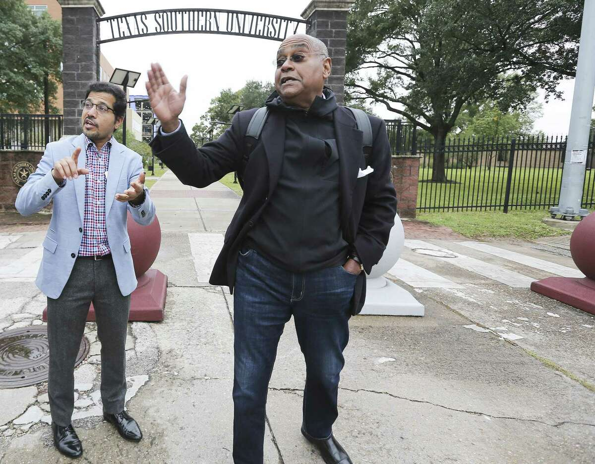 Amar Mohite, Harris County Precinct 1 director of planning and infrastructure, left and Commissioner Rodney Ellis, talk about plans for a new entrance for Texas Southern University that is more pedestrian and cyclist friendly outside the Houston campus on Nov. 19.