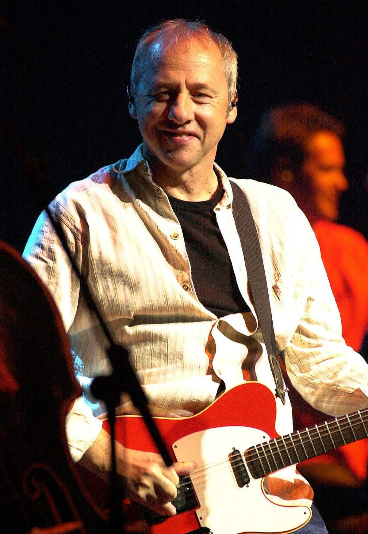 Mark Knopfler, the founder of the band Dire Straits, shown performing in New York in this April 29, 2001 file photo (AP Photo/Stephen Chernin, File)