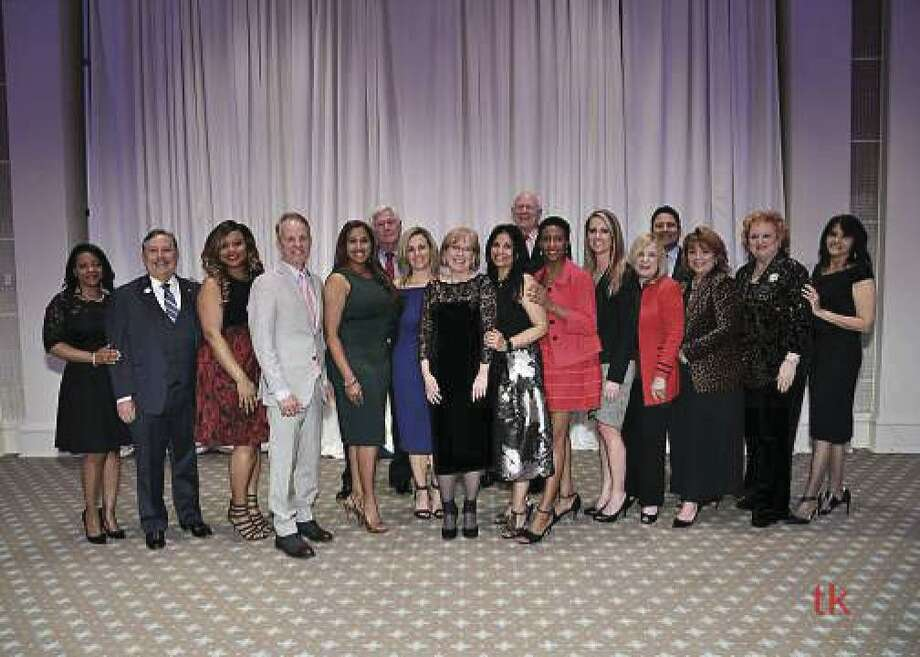 Members of HAR's newly inaugurated 2019 executive committee and board of directors pose at the Houston Country Club. Standing in the center is 2019 HAR Chair Shannon Cobb Evans. At the far left is immediate past chair Kenya Burrell-VanWormer.