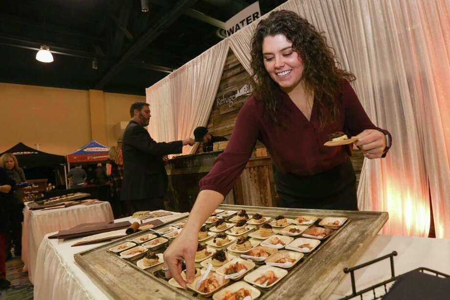 Autumn Zientek, assistant general manager of The Refuge Bar and Bistro, stocks samples of pate brisee and Mexican shrimp cocktail during Taste of the Town on Thursday, Jan. 18, 2018, at The Woodlands Waterway Marriott Hotel & Convention Center. Photo: Michael Minasi, Staff Photographer / Houston Chronicle / © 2017 Houston Chronicle