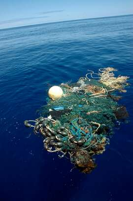 This image provided by the Scripps Institution of Oceanography shows a patch of garbage in the Pacific Ocean on Aug. 11, 2009. Scientists at Scripps Institution of Oceanography on Thursday, Aug. 27, 2009 announced findings from an August expedition to the Great Pacific Garbage Patch, about 1,000 miles west of California. The patch is a vortex formed by ocean currents and collects human-produced trash. (AP Photo/ Scripps Institution of Oceanography, Mario Aguilera) ** NO SALES **