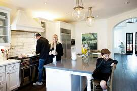 Ramin Ramhormozi, Jenny Romeyn and their son Own 9,  and daughter Avery 5, in their home in Santa Rosa, California, December 26th, 2018.  Jenny Romeyn and her husband Ramin Ramhormozi sold their large home on Skyhawk because they think when all the Fountaingrove homes are rebuilt and on the market, it will be hard to sell a large home in Santa Rosa. They bought a smaller home in need of work near downtown, which is close to both their jobs and their kids' school. They are remodeling the new house and renting back the old house till the end of January.
