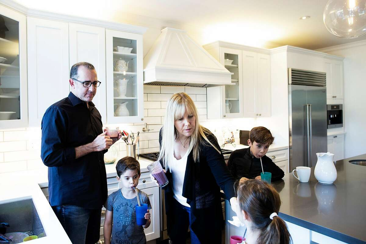 Ramin Ramhormozi (from left), Asher 5, Jenny Romeyn, Avery 5, Owen 9, and in their home in Santa Rosa, California, December 26th, 2018. Jenny Romeyn and her husband Ramin Ramhormozi sold their large home on Skyhawk because they think when all the Fountaingrove homes are rebuilt and on the market, it will be hard to sell a large home in Santa Rosa. They bought a smaller home in need of work near downtown, which is close to both their jobs and their kids' school. They are remodeling the new house and renting back the old house till the end of January.