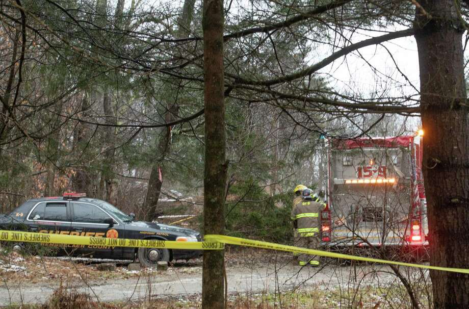 Rensselaer County Sheriff's and State Fire investigators are on scene to try and determine the cause of a fatal fire on at 442 Saddleback Ridge Road Friday Dec. 28, 2018 in East Nassau, N.Y.  (Skip Dickstein/Times Union) Photo: SKIP DICKSTEIN, Albany Times Union / 20045820A