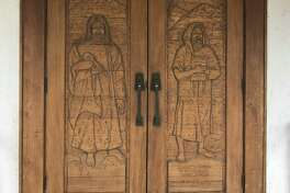 Maisie Lee?'s carvings adorn the front doors of the Methodist church in Marathon.