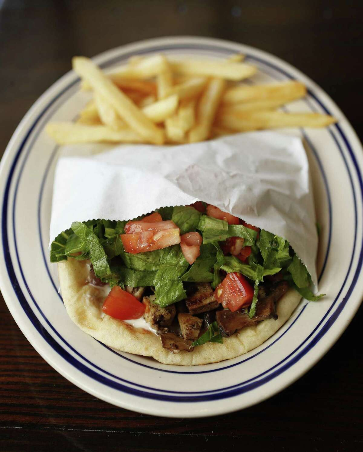 Island Grill, a locally owned restaurant serving Mediterranean cuisine, will open in Springwoods Village in mid-2019. Grilled chicken pita with french fries is on the menu.