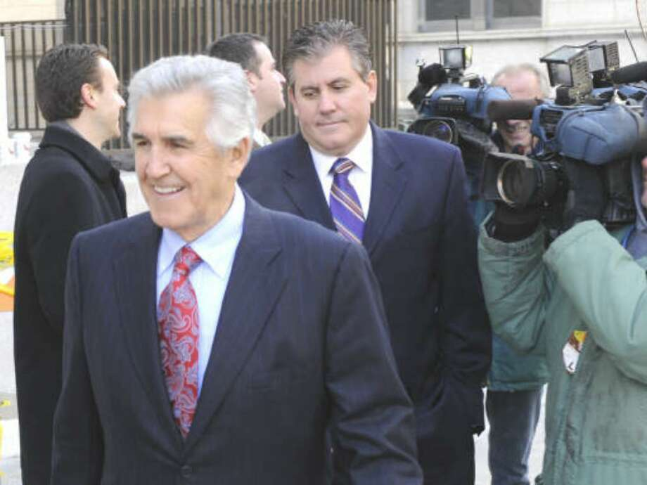 Former State Sen. Joseph Bruno with son Ken Bruno behind him, enters the federal courthouse in Albany, New York November 18, 2009 for the continuation of his trial.    (Skip Dickstein / Times Union)