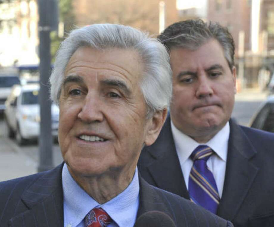 Former state Sen. Joseph L. Bruno with son Ken Bruno behind him, enters the federal courthouse in Albany, New York November 18, 2009 for the continuation of his criminal trial.    (Skip Dickstein / Times Union)