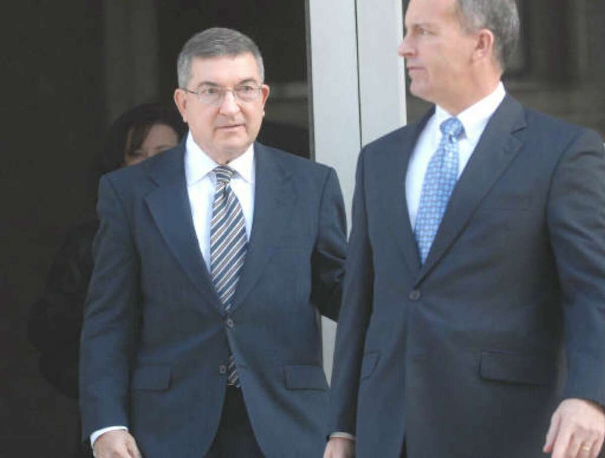 Frank Gluchowski, left, a former Senate ethics lawyer who handled the personal business matters of former Sen. Joseph L. Bruno, leaves the federal courthouse Thursday in Albany.