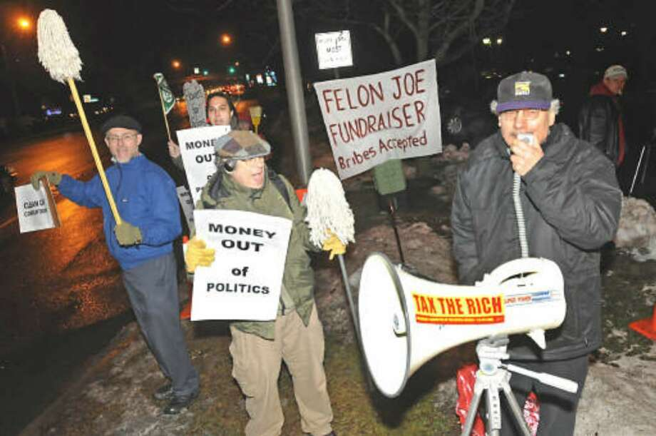 A protest against corrupt government is held Tuesday outside a Colonie fundraiser for formerstate Sen. Majority Leader Joseph L. Bruno. He awaitings sentencing after being convicted of two federal corruption charges. ( LORI VAN BUREN/TIMES UNION)