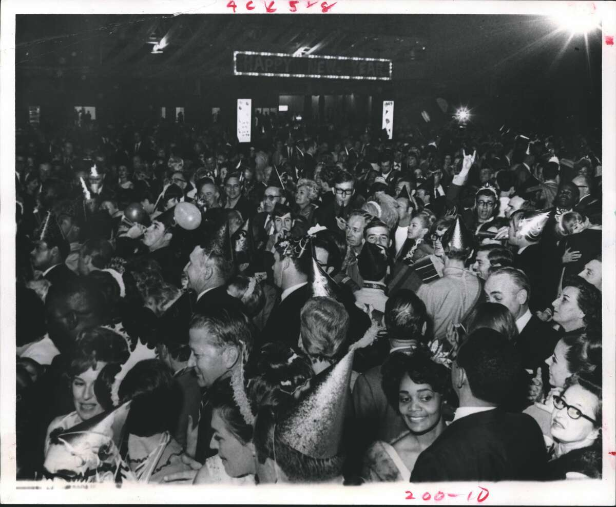1968: New Year's Eve revelers jam the huge dance floor at the Astroball in the Astrohall.