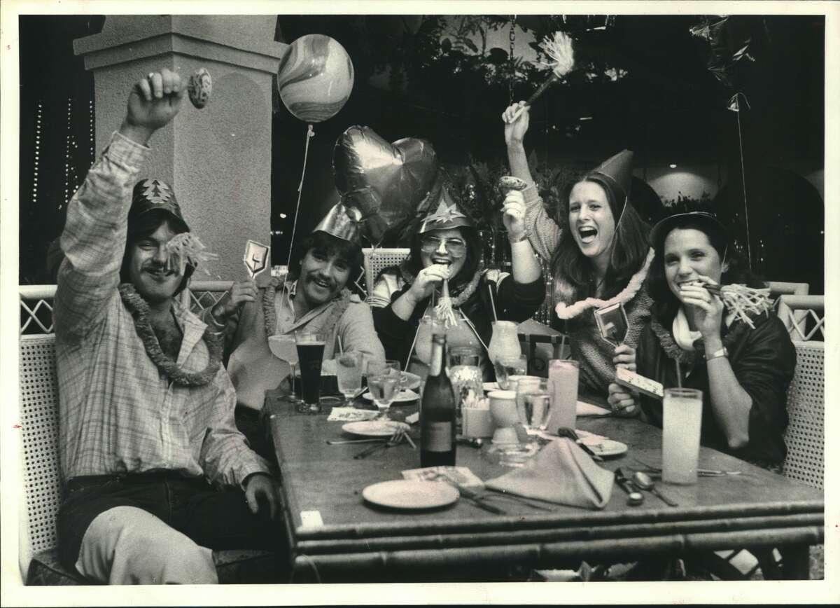 1980: Mark McDonald of Houston, Gary Adkins of Haynesville, La., Michelle Evans of Missouri City, Vicki Adkins of Delhi, La., and Harriet Boddie, of Shreveport, La., ring in the new year at the Cellar Door, 6732 Stella Link.