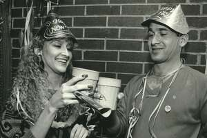 1986: Party-goers Christina Price and Andrew Casas share a toast to the new year in the Hyatt Regency Hotel.