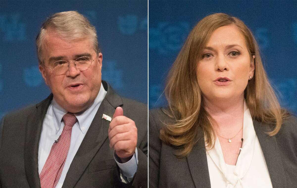 Republican U.S. Rep. John Culberson debates opponent Democrat Lizzie Pannill Fletcher at the University of Houston, Sunday, Oct. 21, 2018, in Houston. Both of them are running for U.S. Congress in Houston's Congressional District 7.