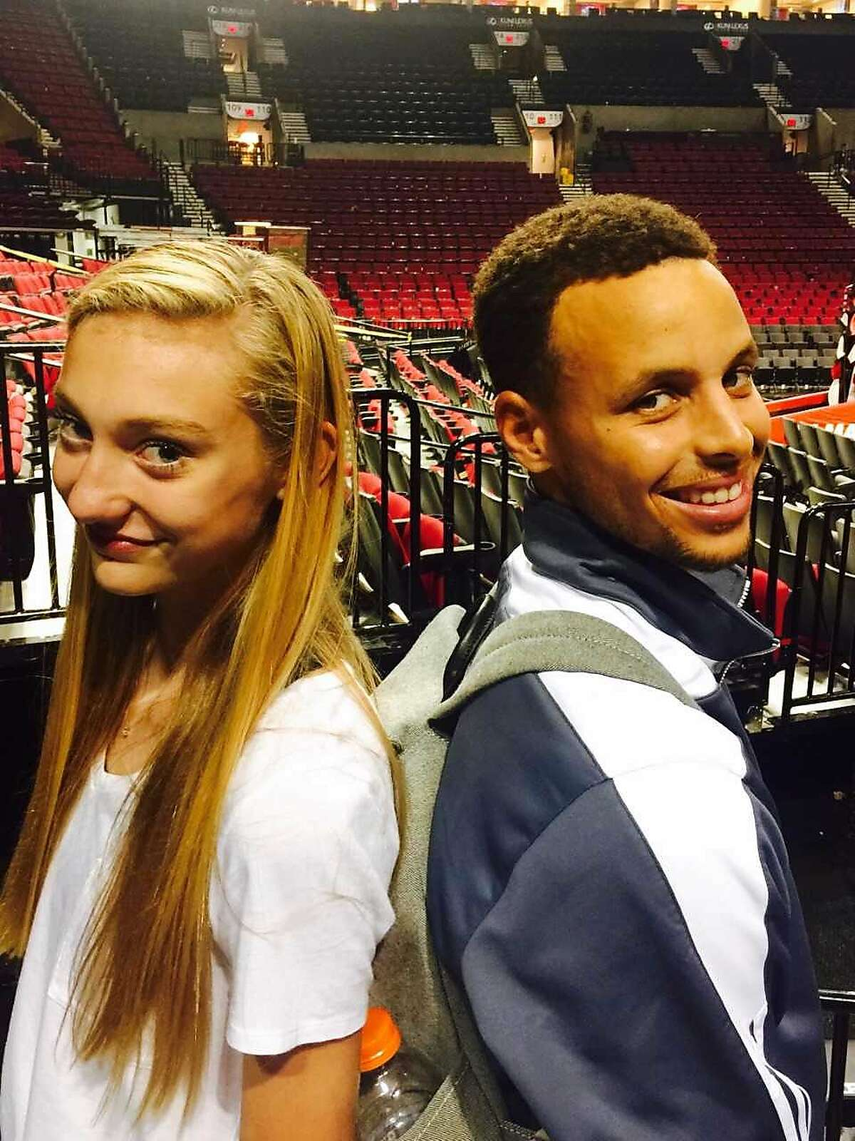 Cameron Brink and Stephen Curry pose after a Warriors-Trail Blazers game in Portland, Ore.