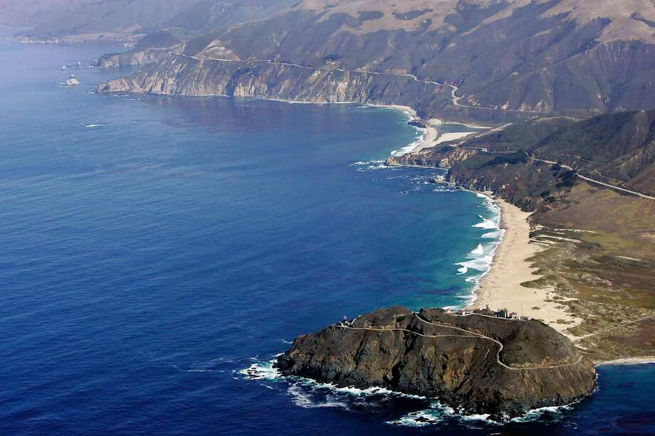 FILE-   This Sept. 24, 2006 file photo shows the Point Sur State Marine Reserve in an aerial view in Big Sur, Calif. The road to Big Sur is a narrow, winding one, with the Pacific Ocean on one side, spread out like blue glass, and a mountainside of redwoods on the other.   (AP Photo/Marcio Jose Sanchez) Photo: Marcio Jose Sanchez / Associated Press 2006