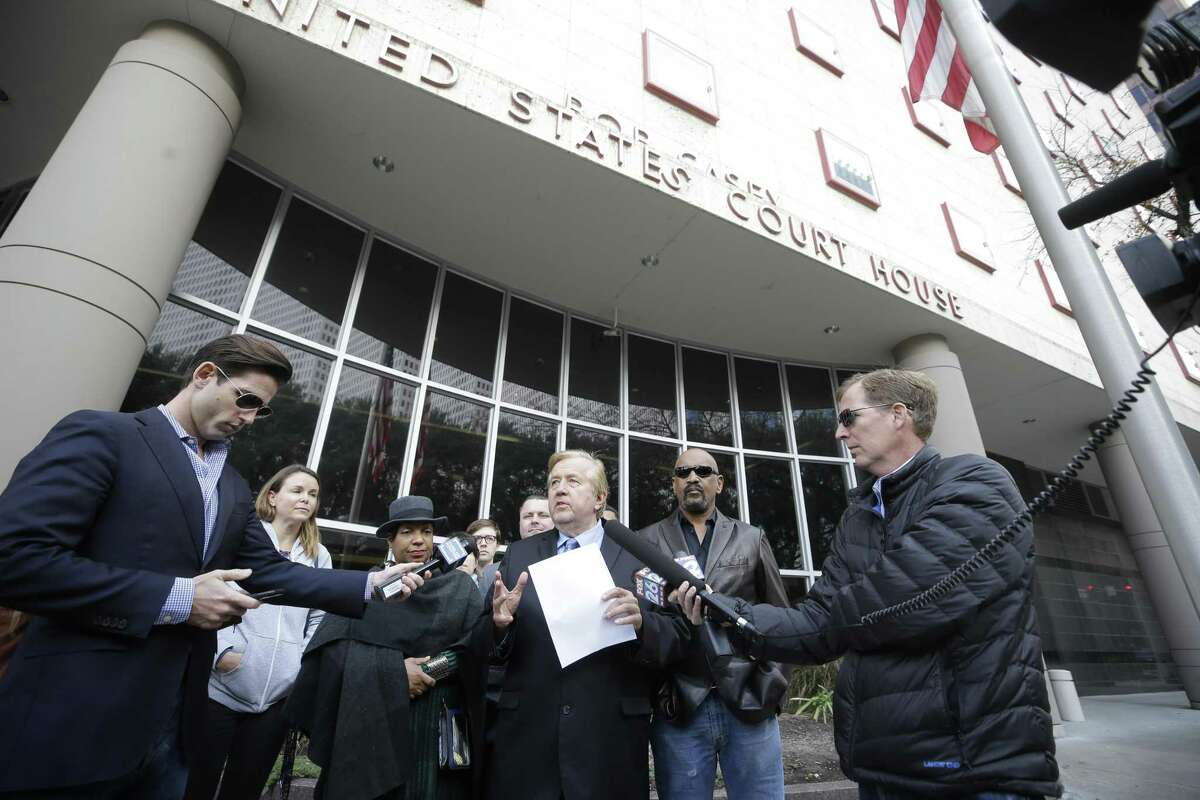 Attorney Randall L. Kallinen, center, holds a press conference outside the Bob Casey Federal Courthouse, 515 Rusk, Friday, Dec. 28, 2018, in Houston. He said a confidential settlement was reached in the Pledge of Allegiance case and the Cy-Fair ISD agreed to inform students of their right to not stand for the Pledge of Allegiance with parental permission.