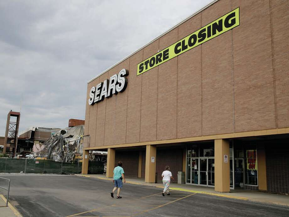 In this July 8, 2017, file photo people walk into a Sears store slated for closing that is next to a mall that is being torn down in Overland Park, Kan. Sears announced Friday that it will close 80 more stores in the coming months, including the location at Fairview Heights' St. Clair Square mall. Photo: AP Photo/Charlie Riedel, File