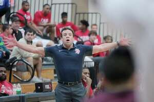 Dawson head coach Mark Barre watched his team rally for a 69-61 overtime win against Strake Jesuit Friday.