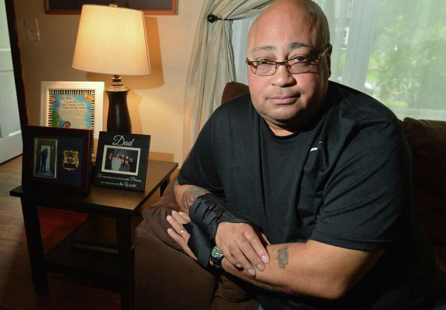 Patrolman Phil Roselle, at his Norwalk Conn. home on Sept.17. The 30-year veteran of the Norwalk Police Department has been off the job for a year after an accidental discharge by another at the police shooting range left him with a bullet lodged in his rib and nerve damage to his right arm, and many other health issues. Photo: Alex Von Kleydorff / Hearst Connecticut Media / Norwalk Hour