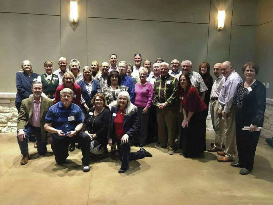 Newly graduated Montgomery County Master Gardeners pose for a photo.