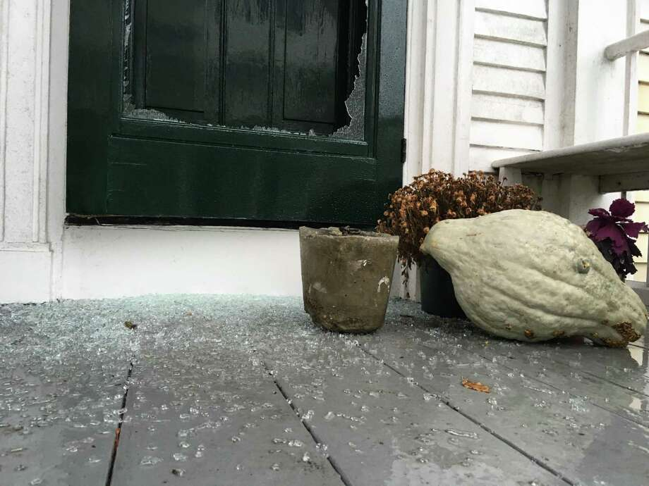 Glass on a door to a North Water Street home in Edgartown, Mass., is shattered following a vandalism spree allegedly committed by Greenwich teens on Martha's Vineyard last week. Photo: Holly Pretsky /Vineyard Gazette