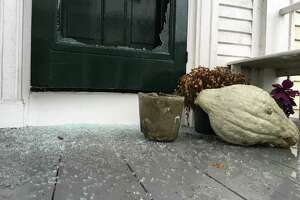 Glass on a door to a North Water Street home in Edgartown, Mass., is shattered following a vandalism spree allegedly committed by Greenwich teens on Martha's Vineyard last week.