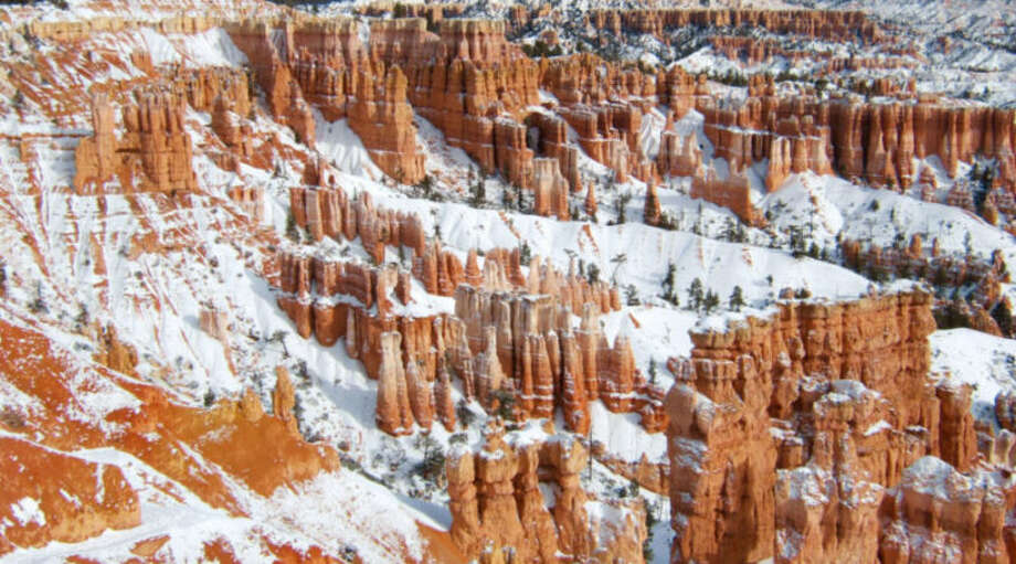 Bryce Canyon National Park, UT Rim Trail, 1-5 mile round-trip The image of Bryce Canyon's hoodoos frosted with snow is one of the most stunning sights in the West. The park's signature hike, the Rim Trail, curves around the rock formation-filled amphitheater and can be tackled as easily or as adventurously as you choose. The mostly flat one-mile round-trip hike from Inspiration point to Sunset Point is fairly reliably open all winter. For more of a challenge, continue onto Fairyland Point, a 4-mile round-trip addition. This section is much steeper, and you're likely to need crampons or clip-on traction devices. Be sure to check for trail closures before setting out. Photo: Courtesy Of REI Adventures / © REI