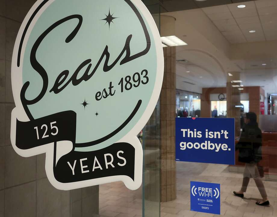 "In this Nov. 2 photo, a sign in the window at Sears promises that ""This isn't goodbye,"" at the Livingston Mall in Livingston, N.J. Photo: Ted Shaffrey / Associated Press"
