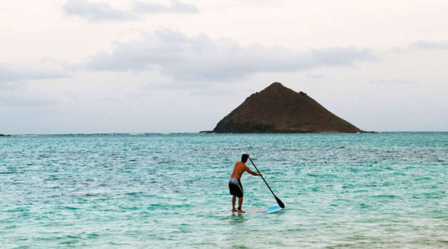 Oahu, HI Volcanic landscapes, dramatic coastlines, and turquoise waters make wellness the default setting on this island paradise. Paddleboard Kailua Beach Park, hike Maunawili Falls Trail, grab a pitaya bowl from Da Cove Health Bar & Café, surf the North Shore with Hans Hedemann Surf School and aloha your worries away. Photo: Erin Kunkel / © Erin Kunkel.