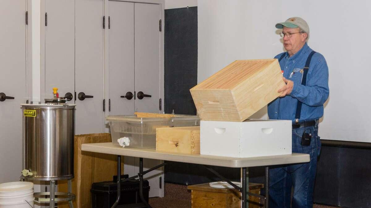 Former Connecticut Beekeepers Associations President Ted Jones explains beekeeping equipment to beekeeping school attendees.