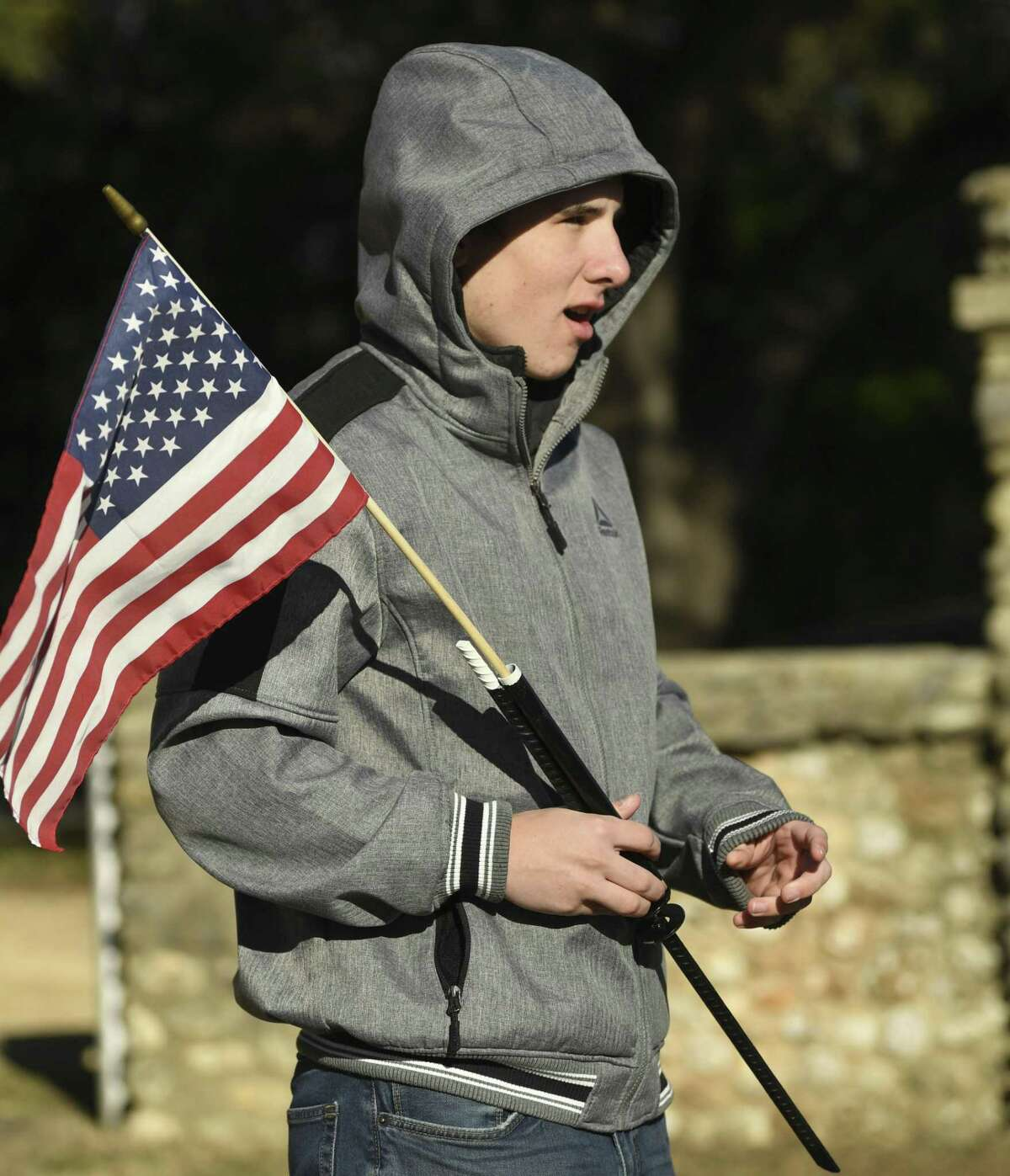 Nathan Burden, 17, has a deep respect for veterans. He is a prospective Eagle Scout. He holds a flag holder which he designed and obtained material and volunteer support to build for the graves of military veterans at Blanco Cemetery.