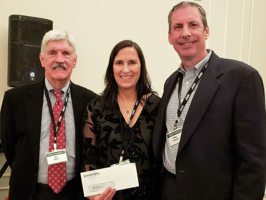 From left are Ed Ryan of GoodWorks Insurance, Kim OBrien Green of Operation Fuel and CEMAs Peter Russell. Photo: Contributed Photo /