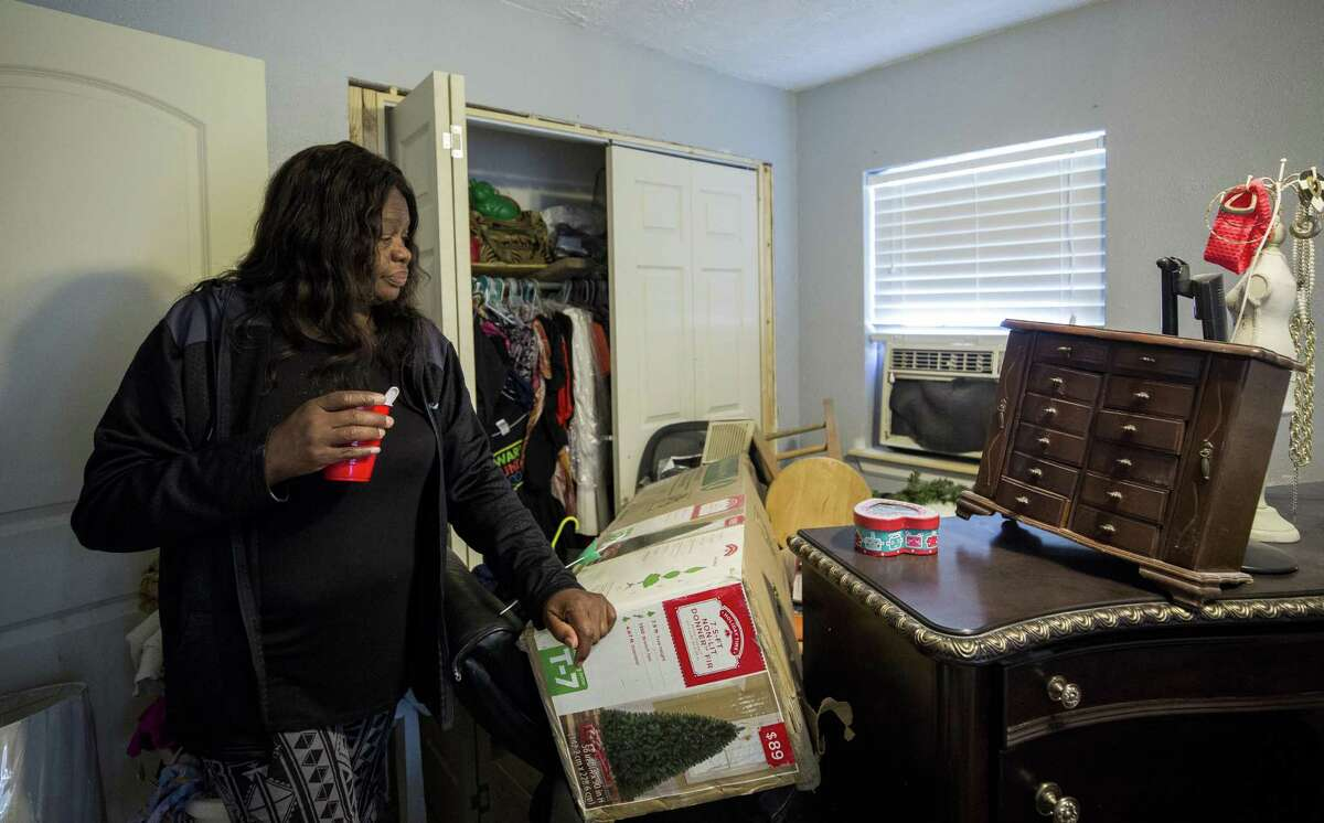 Ann Weston received repairs through the FEMA-funded Harvey home repair program known as PREPS earlier this year, but much of the work molded and has had to be torn out by charitable volunteers, like West Street Recovery, whose workers currently are repairing her home, Thursday, Dec. 20, 2018, in Houston. Weston has yet to use the Christmas tree she bought on a holiday sale late 2016, due to Hurricane Harvey and the lingering repairs. She's one of many low-income people whose homes still aren't in good shape, 16 months after the storm.