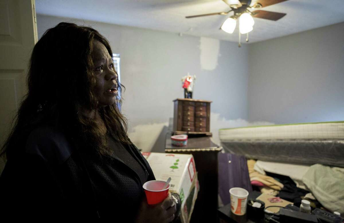 Ann Weston's bedroom has turned into a storage room as nonprofit workers make ongoing repairs on her home, 16 months after Hurricane Harvey, Thursday, Dec. 20, 2018, in Houston.