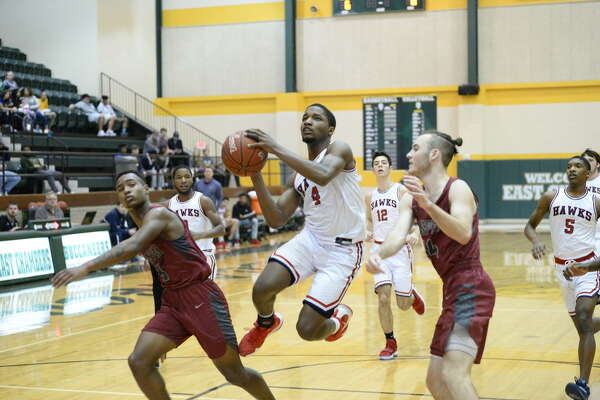 Demetrius Johnson drives to basket for a layup against Jasper on Friday at East Chambers Holiday Tournament.