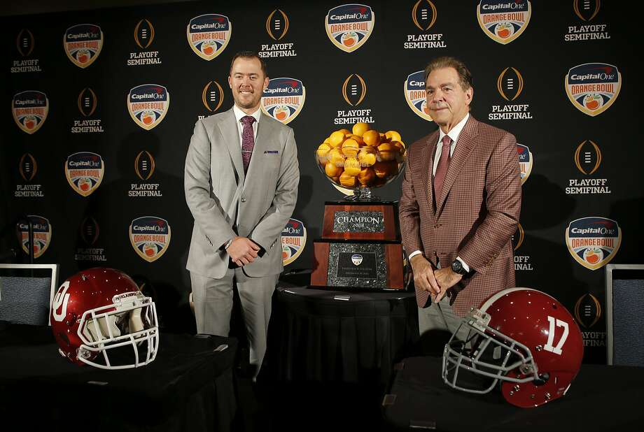 Alabama coach Nick Saban (right) stands with Oklahoma coach Lincoln Riley at a news conference Friday before the teams face off Saturday in the Orange Bowl. Photo: Joe Skipper / Associated Press
